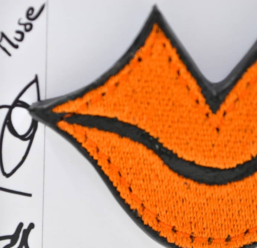 Woman's MUSE brooch embroidered in orange GLORIA BALENSI on calf leather, front zoom view