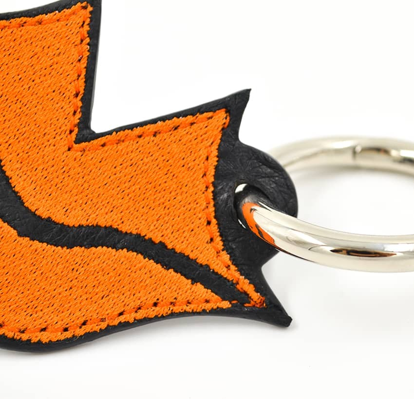 Orange embroidered keychain on leather GLORIA BALENSI, handmade in France zoom view in front