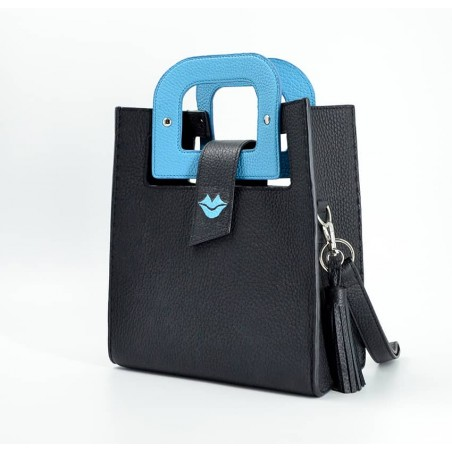 Woman handbag Sky blue artist GLORIA BALENSI in Taurillon leather, view from the side.