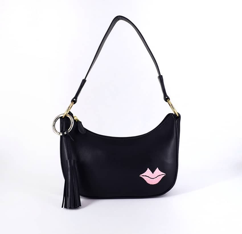 MIA black and pink baguette bag in cowhide leather, front view | Gloria Balensi